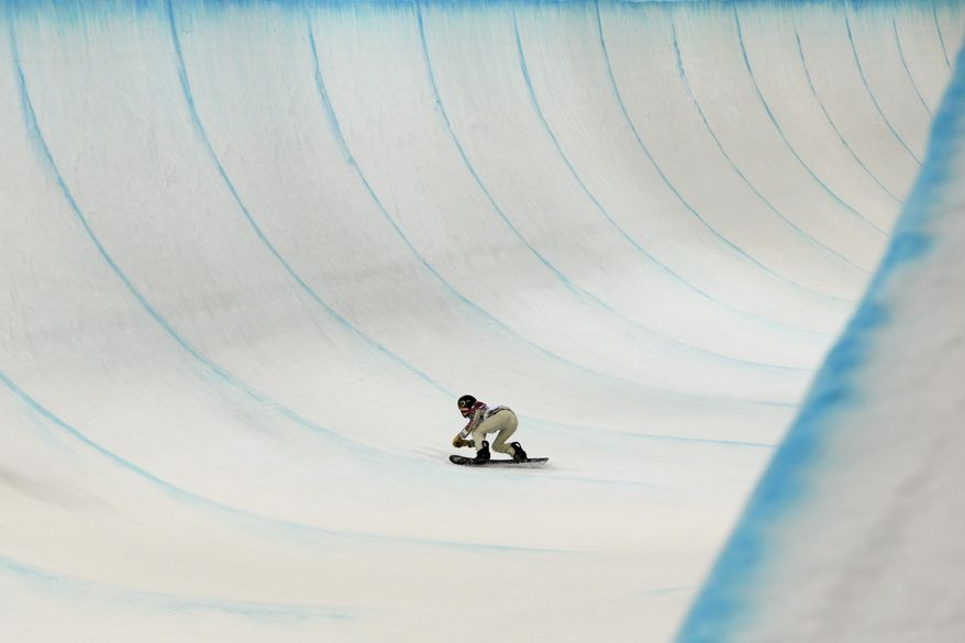 Shaun White, of the United States, competes in the men's snowboard halfpipe final at the Rosa Khutor Extreme Park, at the 2014 Winter Olympics, Tuesday, Feb. 11, 2014, in Krasnaya Polyana, Russia. White placed fourth. (AP Photo/Jae C. Hong)