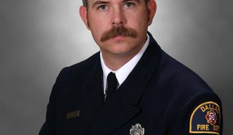 This photo provided by Dallas-Fire Rescue shows Dallas firefighter William Scott Tanksley, 40, who died Monday night, Feb. 10, 2014 after falling from an icy overpass as emergency personnel responded to a traffic accident. (AP Photo/Dallas-Fire Rescue )