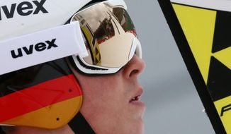 Germany's Eric Frenzel looks at the hill after his attempt at a men's nordic combined training session at the 2014 Winter Olympics, Tuesday, Feb. 11, 2014, in Krasnaya Polyana, Russia. (AP Photo/Dmitry Lovetsky)