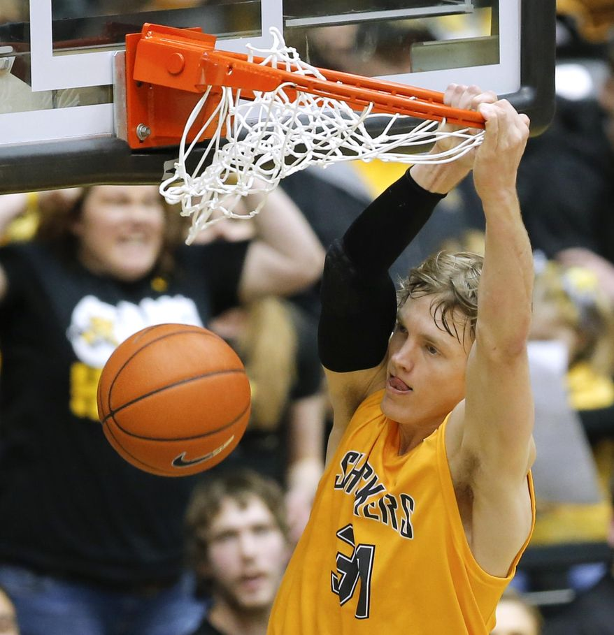 Wichita State's Ron Baker dunks against Southern Illinois during the first half of an NCAA college basketball game Tuesday, Feb. 11, 2014, in Wichita, Kan. (AP Photo/The Wichita Eagle, Travis Heying) LOCAL TV OUT; MAGS OUT LOCAL RADIO OUT; LOCAL INTERNET OUT