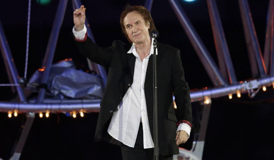 """This Aug. 12, 2012 file photo shows Ray Davies singing """"Waterloo Sunset"""", during the Closing Ceremony at the 2012 Summer Olympics in London. (AP Photo/Charlie Riedel)"""