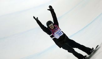 Switzerland's Iouri Podladtchikov celebrates after his second half pipe run during the men's snowboard halfpipe final at the Rosa Khutor Extreme Park, at the 2014 Winter Olympics, Tuesday, Feb. 11, 2014, in Krasnaya Polyana, Russia. Podladtchikov won the gold medal. (AP Photo/Andy Wong)