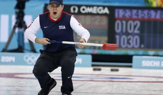 John Shuster, skip of the United States team, reacts as his shot entrers the house during men's curling competition against China at the 2014 Winter Olympics, Tuesday, Feb. 11, 2014, in Sochi, Russia. (AP Photo/Robert F. Bukaty)