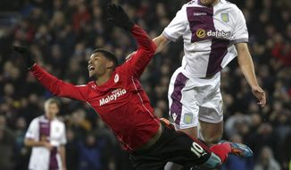 Aston Villa's Nathan Baker, right,  heads the ball from Cardiff City's Fraizer Campbell during their English  Premier League match at the Cardiff City Stadium, Cardiff  Tuesday Feb. 11, 2014. (AP Photo/Nick Potts/PA) UNITED KINGDOM OUT