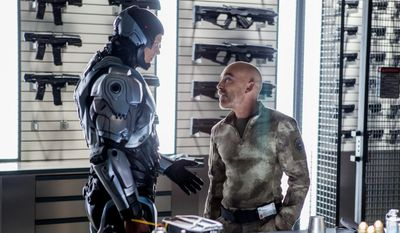 """This image released by Columbia Pictures shows Joel Kinnaman, left, and  Jackie Earle Haley in a scene from """"RoboCop."""" (AP Photo/Columbia Pictures - Sony, Kerry Hayes)"""