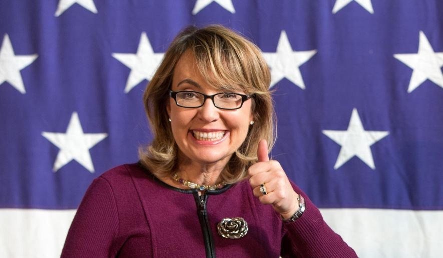 """FILE - This Oct. 27, 2013 file photo shows former U.S. Rep. Gabby Giffords (D-Ariz.), at a fundraiser for U.S. Senate candidate Bruce Braley during the Bruce Blues & BBQ at the Iowa State Fairgrounds in Des Moines, Iowa. Giffords is working on a book about gun control. The Arizona Democrat and her husband, the retired Navy captain and astronaut Mark Kelly, are collaborating on """"Enough: Our Fight to Keep America Safe from Gun Violence.""""  Scribner, an imprint of Simon & Schuster, announced that """"Enough"""" was scheduled for release in June. (AP Photo/Scott Morgan, File)"""