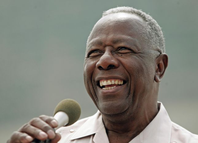 FILE - In this June 7, 2007 file photo, baseball Hall of Famer Hank Aaron smiles as he speaks at a ceremony where a commemorative plaque was unveiled at Miller Park in Milwaukee. Aaron's 80th birthday is celebrated in the nation's capital at a reception hosted by baseball Commissioner Bud Selig, Friday, Feb. 7, 2014.  (AP Photo/Morry Gash, File)