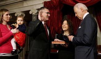 Sen. John Walsh, D-Mont., center, accompanied by his wife Janet, second from right, participates in a ceremonial swearing-in ceremony as Vice President Joe Biden reads the oath of office, Tuesday, Feb. 11, 2014, on Capitol Hill in Washington. Walsh daughter-in-law April Walsh holds his granddughter Kennedy at left.  (AP Photo/Lauren Victoria Burke)