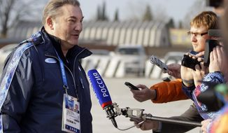 Vladislav Tretiak, a former goaltender for Russia's national ice hockey team, talks with reporters at the Sochi International Airport where NHL hockey players are arriving for the 2014 Winter Olympics, Monday, Feb. 10, 2014, in Sochi, Russia. (AP Photo/Mark Humphrey)