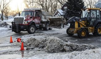 Road crews work to repair a broken water main Tuesday, Feb. 11, 2014, in Bay City, Mich. Crews had to close a five-block stretch of street to deal with a water main break. (AP Photo/The Bay City Times, Andrew Dodson) LOCAL TV OUT; LOCAL INTERNET OUT