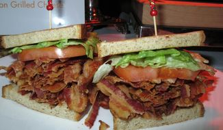 This Monday, Feb. 10. 2014 photo shows a bacon-lettuce-and-tomato sandwich made with an entire pound of bacon at the Tropicana Casino and Resort in Atlantic City, N.J. The casino's Bacon Week festival includes unusual offerings like bacon milk shakes, bacon cupcakes, bacon bloody Marys, beer, vodka and bourbon, and even bacon-flavored toothpaste, dental floss and lip balm. (AP Photo/Wayne Parry)