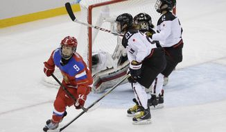 Alexandra Vafina of Russia smiles after scoring the game winning goal against Japan during the third period of the 2014 Winter Olympics women's ice hockey game at Shayba Arena, Tuesday, Feb. 11, 2014, in Sochi, Russia. Russia defeated Japan 2-1. (AP Photo/Mark Humphrey)