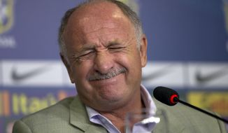 Brazil's soccer coach Luiz Felipe Scolari gestures during a press conference to announce his list of players for an upcoming friendly match with South Africa in Rio de Janeiro, Brazil, Tuesday, Feb. 11, 2014. Brazil will face South Africa on March 5. (AP Photo/Silvia Izquierdo)
