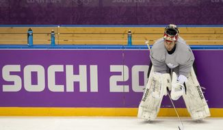 Team Canada goalie Roberto Luongo watches a drill during practice at the Sochi Winter Olympics Tuesday, Feb. 11, 2014, in Sochi, Russia. (AP Photo/The Canadian Press, Adrian Wyld)