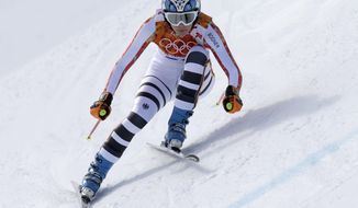 Germany's Maria Hoefl-Riesch makes a turn during the downhill portion of the women's supercombined at the Sochi 2014 Winter Olympics, Monday, Feb. 10, 2014, in Krasnaya Polyana, Russia. (AP Photo/Luca Bruno)