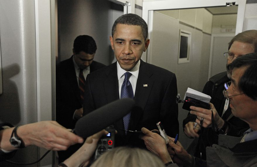 **FILE** President Barack Obama speaks to reporters on Air Force One shortly after landing in Springfield, Ill., Thursday, Feb. 12, 2009. (AP Photo/Charles Dharapak)