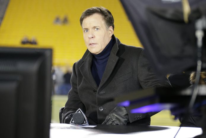 **FILE** Bob Costas is on the set on the field before an NFL football game between the Pittsburgh Steelers and the Cincinnati Bengals on Sunday, Dec. 15, 2013 in Pittsburgh. (AP Photo/Gene J. Puskar)