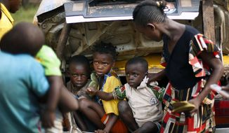 **FILE** Christian children from the village of Bouebou, some 30 miles North of Bangui, Central African Republic, are packed in the trunk of a taxi to flee sectarian violence Wednesday Dec. 4, 2013. (AP Photo/Jerome Delay)