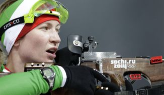 Belarus' Darya Domracheva shoots during the women's biathlon 10k pursuit, at the 2014 Winter Olympics, Tuesday, Feb. 11, 2014, in Krasnaya Polyana, Russia. (AP Photo/Lee Jin-man)