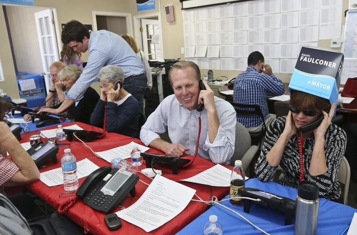 San Diego mayoral candidate Kevin Faulconer sits among  his volunteers calling voters Tuesday, Feb. 11, 2014, in San Diego. Faulconer faces fellow city commissioner David Alvarez in the race to replace disgraced mayor Bob Filner.  (AP Photo/Lenny Ignelzi)