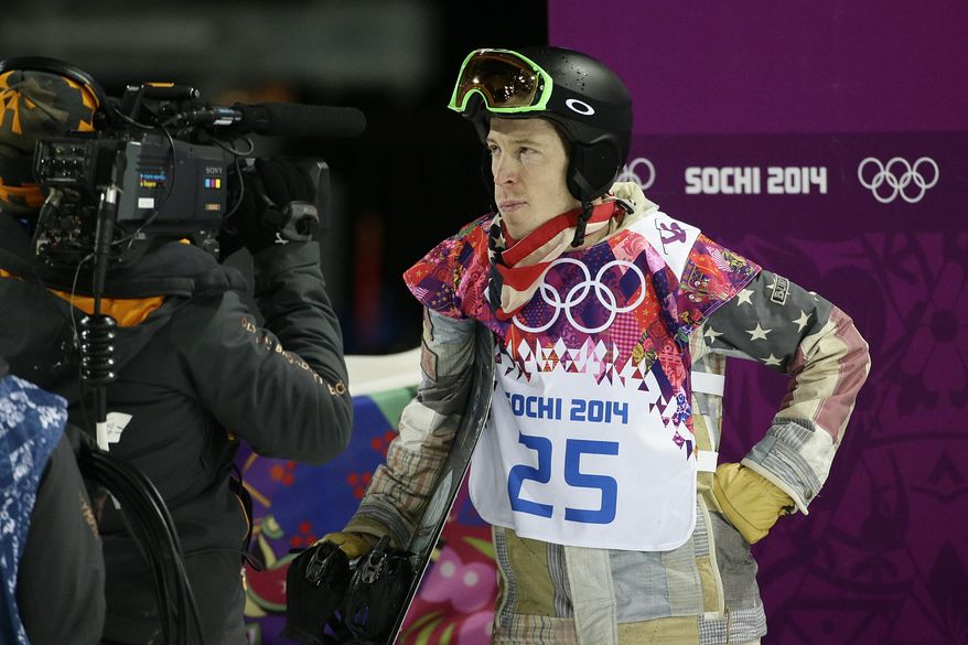 Shaun White, of the United States, looks at the scoreboard after competing in the men's snowboard halfpipe final at the Rosa Khutor Extreme Park, at the 2014 Winter Olympics, Tuesday, Feb. 11, 2014, in Krasnaya Polyana, Russia. White placed fourth. (AP Photo/Jae C. Hong)