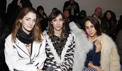 Sophia Sanchez, from left, Gia Coppola and Delfina Delettrez Fendi attend the Rodarte 2014 Fall/Winter Collection during Mercedes Benz Fashion Week on Tuesday, Feb. 11, 2014, in New York. (Photo by Amy Sussman/Invision/AP)