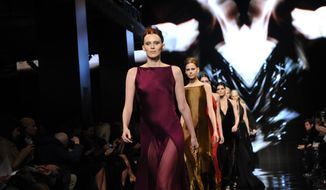 Model Karen Elson leads the finale for the Donna Karan New York Fall 2014 collection during Fashion Week,  Monday, Feb. 10, 2014, at 23 Wall Street in New York.  (AP Photo/Diane Bondareff)