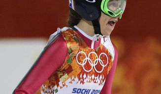 United States' Sarah Hendrickson smiles after her trial jump during the women's normal hill ski jumping final at the 2014 Winter Olympics, Tuesday, Feb. 11, 2014, in Krasnaya Polyana, Russia. (AP Photo/Gregorio Borgia)