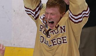 Boston College Patrick Brown, who scored the go-ahead goal and eventual game-winner, hoists the Beanpot trophy after defeating Northeastern 4-1 for the Eagle's 5th straight  title at TD Garden on Monday, Feb. 10, 2014.  (AP Photo/Boston Herald, Matthew West)
