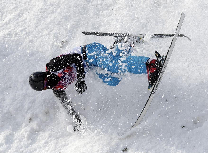 Kazakstan's Baglan Inkarbek crashes during freestyle skiing aerials training at the Rosa Khutor Extreme Park at the 2014 Winter Olympics, Monday, Feb. 10, 2014, in Krasnaya Polyana, Russia. (AP Photo/Andy Wong)