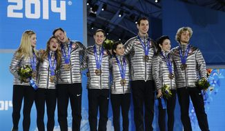 Team figure skating bronze medalists from the United States pose with their medals during the medals ceremony at the 2014 Winter Olympics in Sochi, Russia, Monday, Feb. 10, 2014.  (AP Photo/Morry Gash)