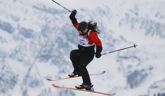 Paraguay's Julia Marino takes a jump during the women's freestyle skiing slopestyle qualifying at the Rosa Khutor Extreme Park, at the 2014 Winter Olympics, Tuesday, Feb. 11, 2014, in Krasnaya Polyana, Russia.(AP Photo/Sergei Grits)