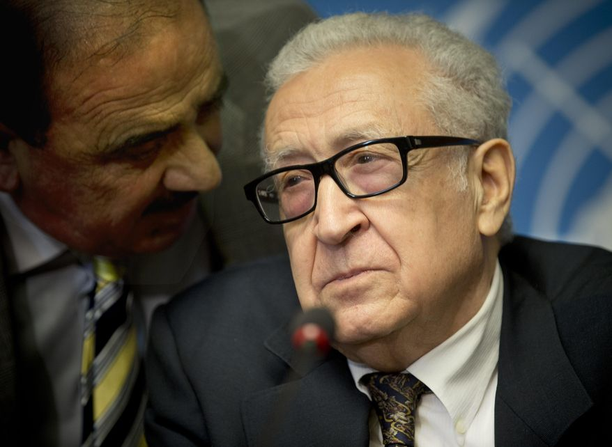 U.N. mediator Lakhdar Brahimi, right, gets information from an aide prior to a press briefing at the United Nations headquarters in Geneva, Switzerland, Switzerland, Tuesday, Feb 11, 2014. A second round of peace talks between the Syrian government and the opposition bogged down quickly Tuesday in recriminations about who was responsible for escalating violence that has killed hundreds in the past few days and disrupted food aid for trapped civilians. (AP Photo/Anja Niedringhaus)