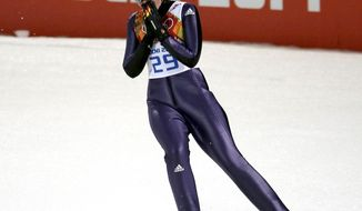 Germany's Carina Vogt reacts after her jump to win the gold during the women's normal hill ski jumping final at the 2014 Winter Olympics, Tuesday, Feb. 11, 2014, in Krasnaya Polyana, Russia. (AP Photo/Charlie Riedel)