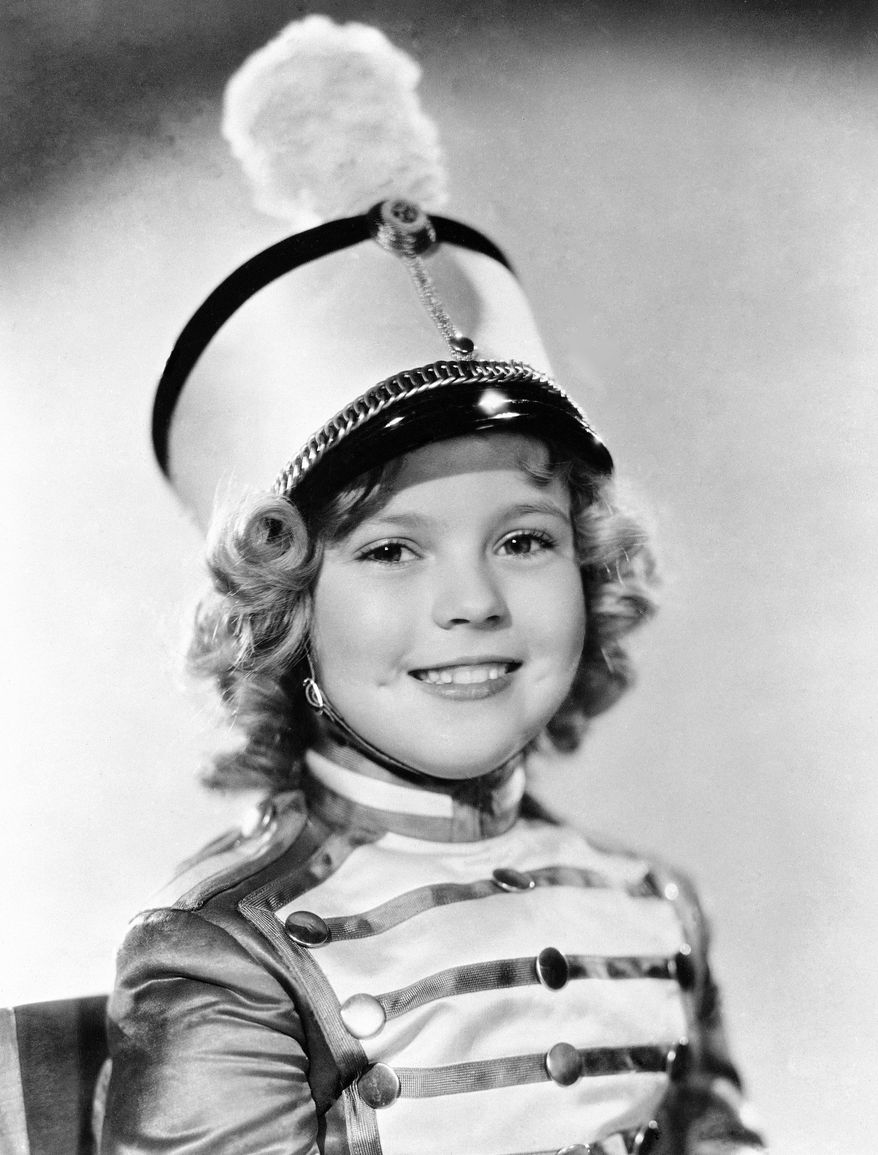 """FILE - In this 1936 file photo, actress Shirley Temple is photographed as she appeared in """"Poor Little Rich Girl."""" Temple, who was born in 1928 and began acting at the age of three, received an honorary Academy Award in 1934 for her contributions as a child film star. Shirley Temple, the curly-haired child star who put smiles on the faces of Depression-era moviegoers, has died. She was 85. Publicist Cheryl Kagan says Temple, known in private life as Shirley Temple Black, died Monday night, Feb. 10, 2014, surrounded by family at her home near San Francisco. (AP Photo/File)"""