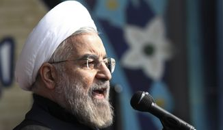 ** FILE ** Iranian President Hassan Rouhani, delivers a speech during an annual rally commemorating anniversary of the 1979 Islamic revolution, at the Azadi 'Freedom' Square in Tehran, Iran, Tuesday, Feb. 11, 2014. (AP Photo/Vahid Salemi)