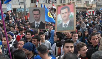 In this photo released by the Syrian official news agency SANA,  supporters of Syrian President Bashar Assad, hold up his portraits as they march during a demonstration is solidarity with government forces, in al-Inshaat neighborhood of Homs, Syria, Wednesday Feb. 11, 2014. Meanwhile the Syrian government on Tuesday allowed over a hundred men of fighting age to leave rebel-held areas of the besieged city of Homs after they were questioned and cleared of rebel links, state media said. (AP Photo/SANA)