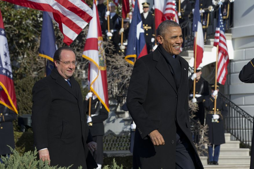 """President Barack Obama walks with French President Francois Hollande on the South Lawn of the White House in Washington, Tuesday, Feb. 11, 2014, during a state arrival ceremony for Hollande. Lauding the """"enduring alliance"""" between the United States and France, President Barack Obama on Tuesday welcomed President Francois Hollande to the White House for a lavish state visit. The highly anticipated trip is taking place amid swirling speculation on both sides of the Atlantic about problems in Hollande's personal life. (AP Photo/Jacquelyn Martin)"""