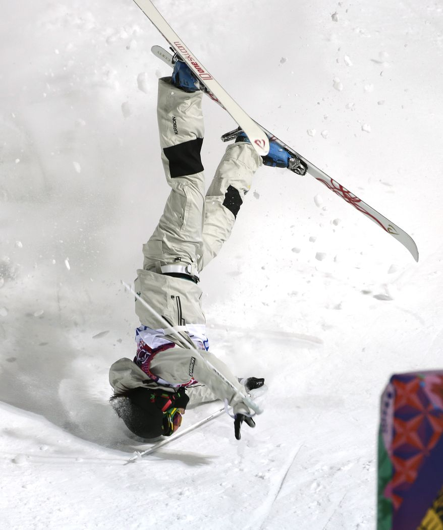 Australia's Nicole Parks crashes at the finish of the moguls slope during a moguls training session at the Rosa Khutor Extreme Park, prior to the 2014 Winter Olympics, Tuesday, Feb. 4, 2014, in Krasnaya Polyana, Russia. (AP Photo/Andy Wong)