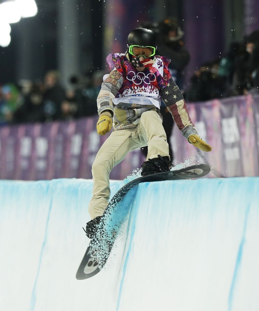 Shaun White of the United States hits the edge of the half pipe during the men's snowboard halfpipe final at the Rosa Khutor Extreme Park, at the 2014 Winter Olympics, Tuesday, Feb. 11, 2014, in Krasnaya Polyana, Russia. (AP Photo/Andy Wong)