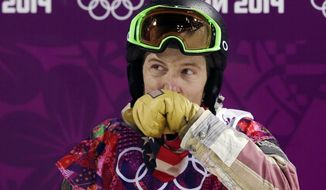 Shaun White of the United States wipes his face after colliding the edge of the half pipe during the men's snowboard halfpipe final at the Rosa Khutor Extreme Park, at the 2014 Winter Olympics, Tuesday, Feb. 11, 2014, in Krasnaya Polyana, Russia. (AP Photo/Andy Wong)
