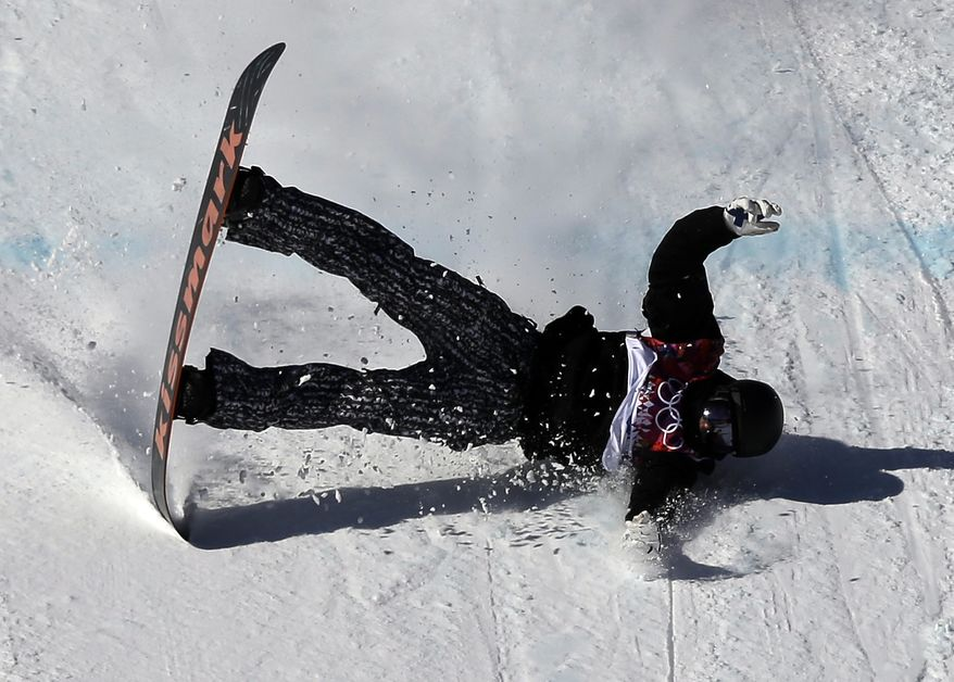 Finland's Janne Korpi crashes during the men's snowboard slopestyle qualifying at the Rosa Khutor Extreme Park ahead of the 2014 Winter Olympics, Thursday, Feb. 6, 2014, in Krasnaya Polyana, Russia.  (AP Photo/Andy Wong)