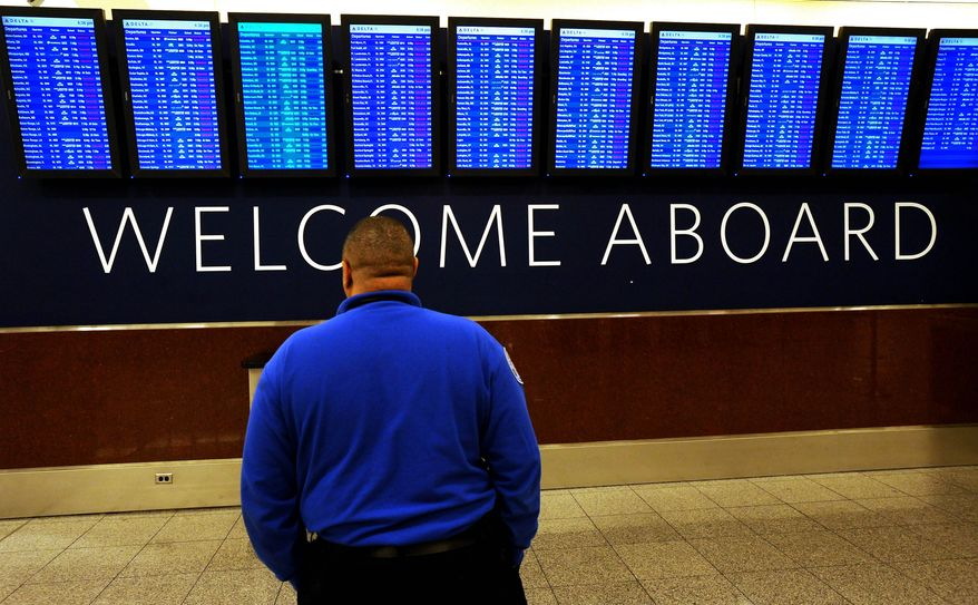 "The departure board indicates hundreds of canceled Delta Air Lines flights into and out of Hartsfield-Jackson International Airport in advance of an ice storm expected to hit the metro Atlanta area later Tuesday, Feb. 11, 2014 in Atlanta. The city dodged the first punch of a dangerous winter storm Tuesday, but forecasters warned of a potentially ""catastrophic"" second blow in a thick layer of ice that threatened to bring hundreds of thousands of power outages and leave people in their cold, dark homes for days.  (AP Photo/David Tulis)"