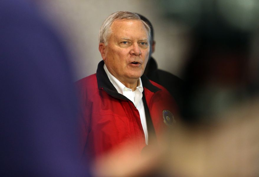 """Gov. Nathan Deal speaks at the GEMA command center, Tuesday, Feb. 11, 2014 in Atlanta. The city dodged the first punch of a dangerous winter storm Tuesday, but forecasters warned of a potentially """"catastrophic"""" second blow in the form of a thick layer of ice that threatened to bring hundreds of thousands of power outages and leave people in their cold, dark homes for days. (AP Photo/Atlanta Journal-Constitution, Ben Gray)  MARIETTA DAILY OUT; GWINNETT DAILY POST OUT; LOCAL TV OUT; WXIA-TV OUT; WGCL-TV OUT"""