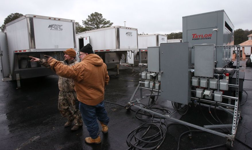 "Georgia Power contractors set up living quarters for up to 500 tree workers in the White Water parking lot, Tuesday, Feb. 11, 2014 in Marietta, Ga. The city of Atlanta dodged the first punch of a dangerous winter storm Tuesday, but forecasters warned of a potentially ""catastrophic"" second blow in the form of a thick layer of ice that threatened to bring hundreds of thousands of power outages and leave people in their cold, dark homes for days. (AP Photo/Atlanta Journal-Constitution, Bob Andres)  MARIETTA DAILY OUT; GWINNETT DAILY POST OUT; LOCAL TV OUT; WXIA-TV OUT; WGCL-TV OUT"