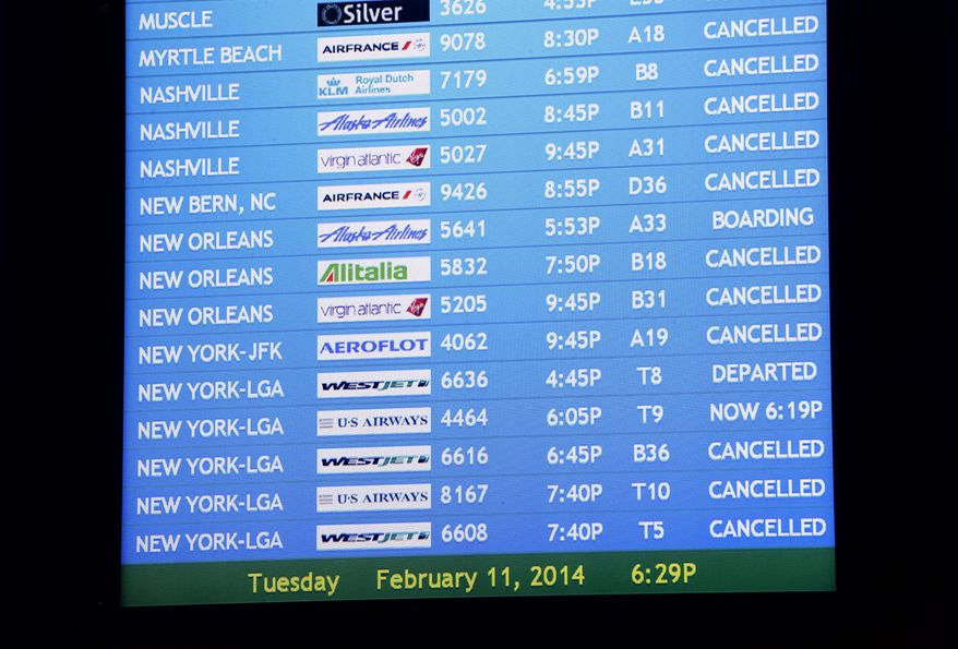 "According to airline spokespersons, Delta Air Lines cancelled 573 flights and Southwest Airlines suspended most operations into and out of Hartsfield-Jackson International Airport in advance of an ice storm expected to hit the metro Atlanta area later Tuesday, Feb. 11, 2014 in Atlanta. The city dodged the first punch of a dangerous winter storm Tuesday, but forecasters warned of a potentially ""catastrophic"" second blow in a thick layer of ice that threatened to bring hundreds of thousands of power outages and leave people in their cold, dark homes for days.  (AP Photo/David Tulis)"