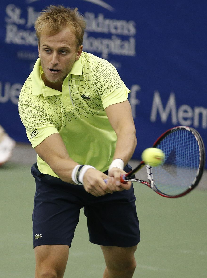 Denis Kudla hits a return to Donald Young in the second round match at the U.S. National Indoor Tennis  Championships on Wednesday, Feb. 12, 2014, in Memphis, Tenn. (AP Photo/Rogelio V. Solis)