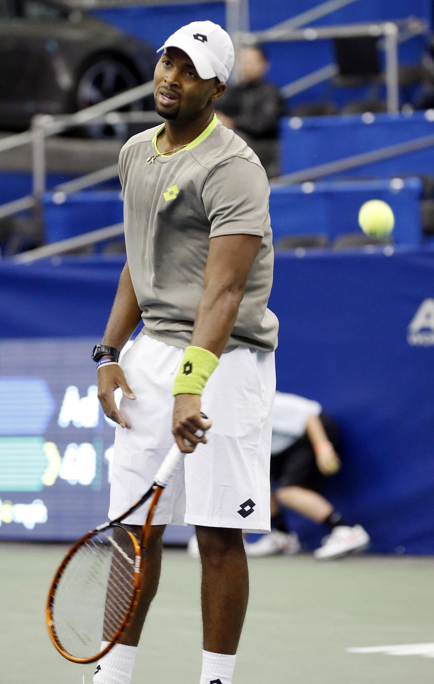 Donald Young reacts to missing a return by  Denis Kudla in the second round match at the U.S. National Indoor Tennis  Championships on Wednesday, Feb. 12, 2014, in Memphis, Tenn. (AP Photo/Rogelio V. Solis)