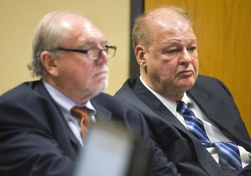 """Attorney Michael Kimerer, left, works on behalf of Arizona Attorney General Tom Horne, right, during a hearing on Feb. 10, 2014 in Phoenix, Ariz.  A prosecutor says evidence will show that Horne was in constant communication with Kathleen Winn, an aide who was running an independent group backing him in the 2010 election, and she passed along his suggestions about campaign ads attacking his Democratic rival to her campaign consultant. That """"coordination"""" is illegal in Arizona, and Kreutzberg told a judge hearing a civil case brought against Horne and Winn that interviews and telephone, email and other records gathered during an FBI investigation will prove it. (AP Photo/The Arizona Republic, Tom Tingle)  MARICOPA COUNTY OUT; MAGS OUT; NO SALES"""