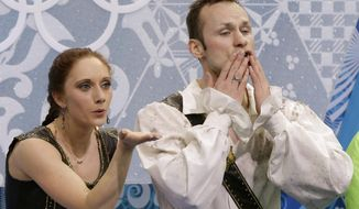 Maylin Wende and Daniel Wende of Germany blow kisses to spectators in the results area after competing in the pairs free skate figure skating competition at the Iceberg Skating Palace during the 2014 Winter Olympics, Wednesday, Feb. 12, 2014, in Sochi, Russia. (AP Photo/Darron Cummings)